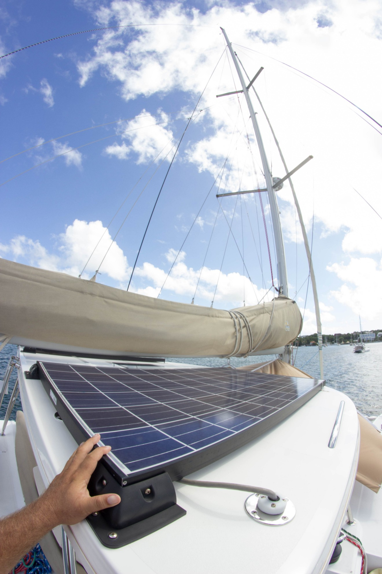 The hard bimini over the flybridge carries two Kyocera 255 watt solar panels