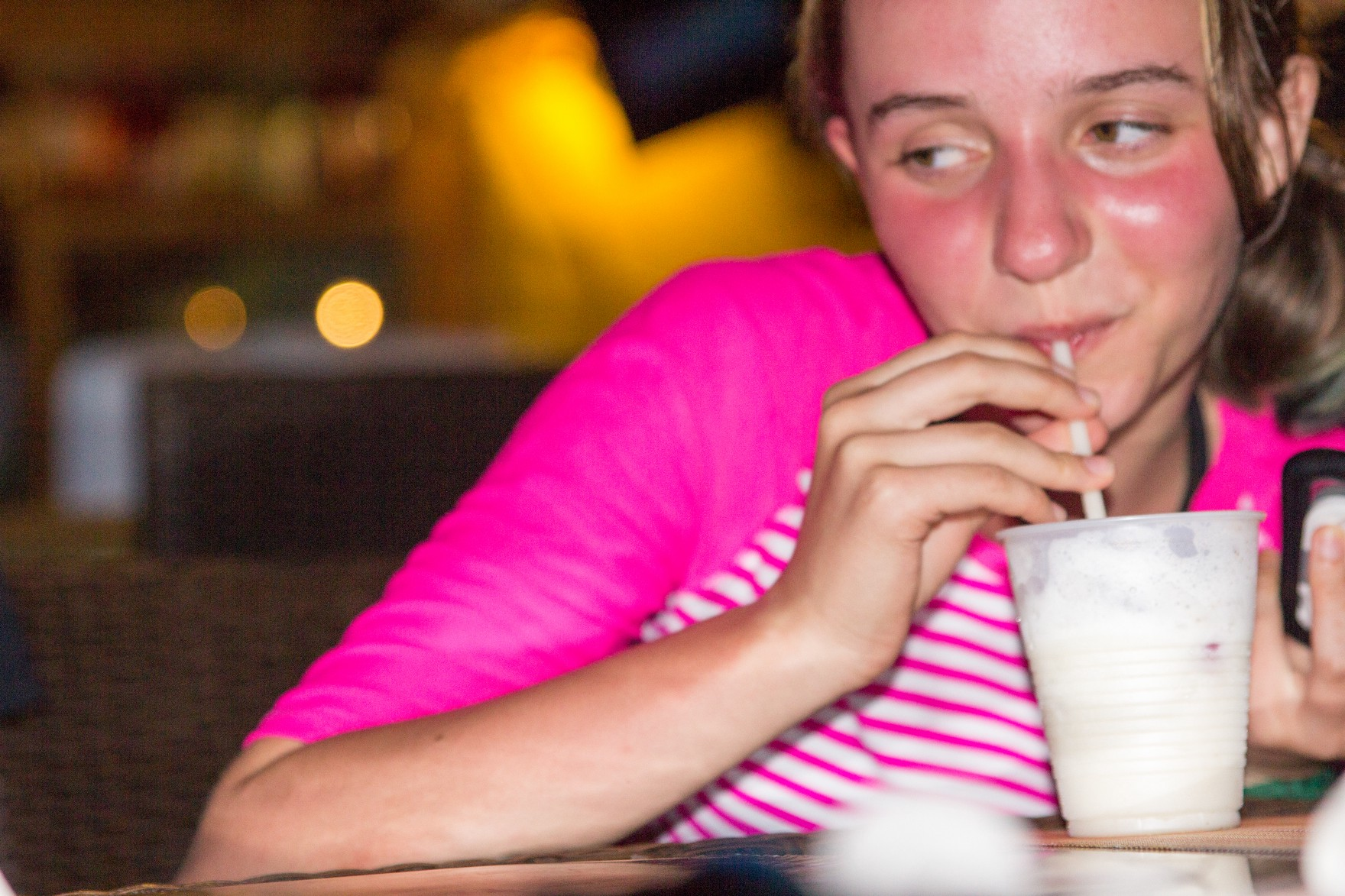Annie sipping a Virgin Pina Colada at the Loose Mongoose in Trellis Bay